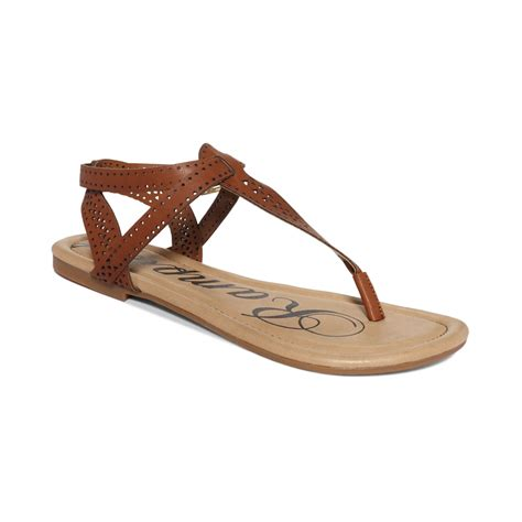 brown sandals lyst rage pasha tstrap flat sandals in brown