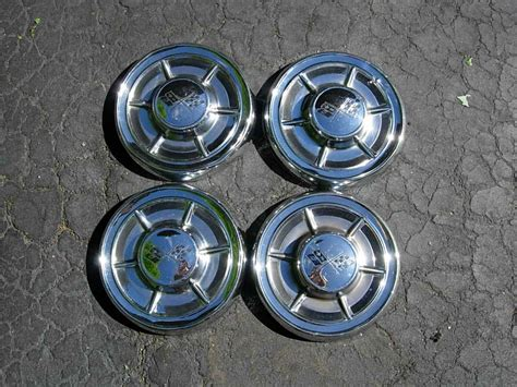 1962 corvette hubcaps 1962 speedometer small hubcaps bumper brackets and