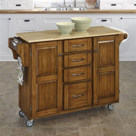 kitchen island shop shop home styles 52 5 in l x 18 in w x 35 75 in h cottage oak kitchen island casters at lowes