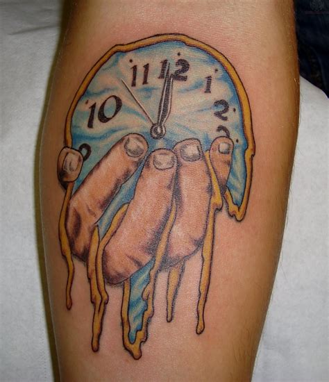 melting clock tattoo melting dali clock on arm