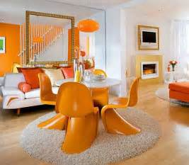 fancy white and orange living and dining room decor