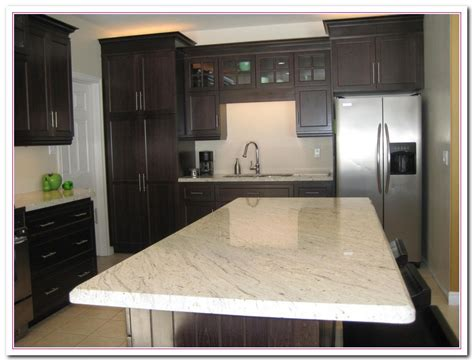 Working On White Granite Countertop For Luxury Kitchen White Granite Kitchen Countertops