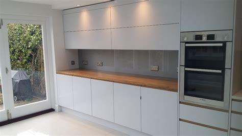 contemporary glass splashback kitchen kitchens kitchen silver grey glass splashbacks