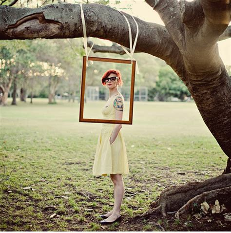 backyard photography ideas trend alert hanging frames photo booth hanging frames