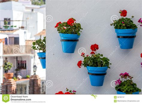 planters that hang on the wall flower pots in mijas stock photo image 56783747