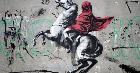 paris banksy spreads  trail  graffiti  rumors