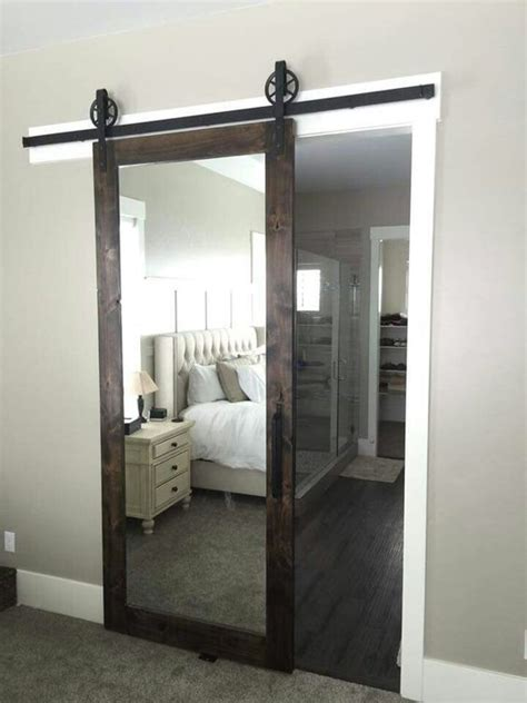 barn door ideas for bathroom this mirrored barn door for a master bedroom