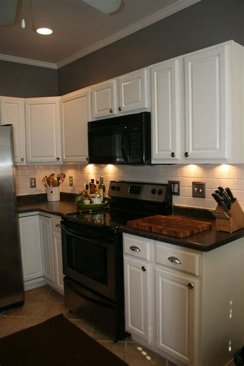 kitchen white appliances black countertop white cabinets home design