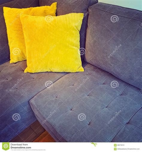 yellow couch cushions corner sofa with bright yellow cushions stock photo