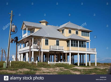 beach houses on stilts wooden house on stilts on beach front galveston texas usa