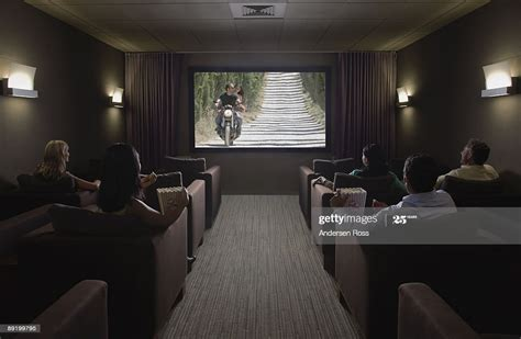 watching   home theater stock photo getty images
