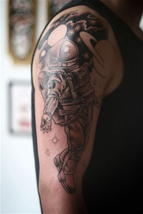 black and grey spaceman half sleeve in progress by adam