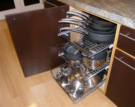 kitchen cabinet organizers for pots and pans roll out storage racks keep cabinets organized and pots and pans accessible tiny house