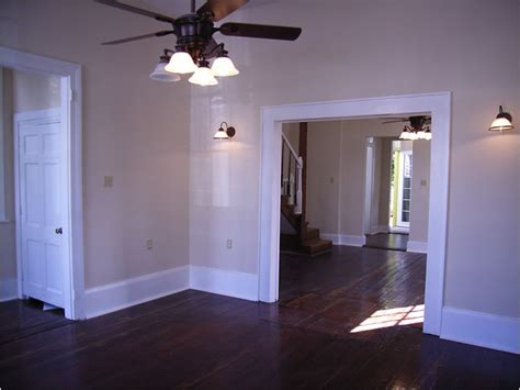 restaining wood trim dark wood floors with thick white trim for the home