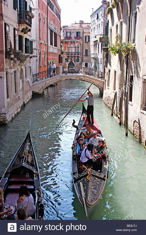 boat ride in venice gondoliers take tourists to venice on a boat ride through