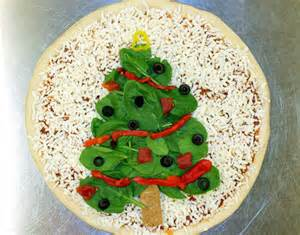 a domino s pizza with a christmas tree topping