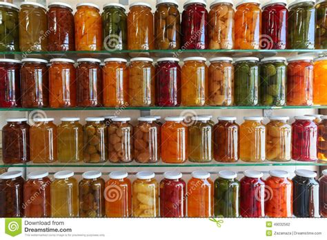 storage shelves of home canning fruits and vegetables