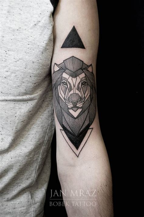 black ink geometric lion head tattoo on left bicep