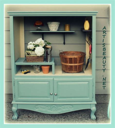 outdoor armoire hometalk old entertainment center turned into a potting shed