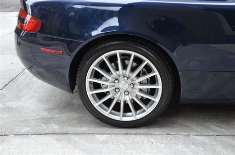 manual repair autos 2006 aston martin db9 volante instrument cluster service manual how to bleed brakes on a 2006 aston martin db9 volante how to bleed brakes on