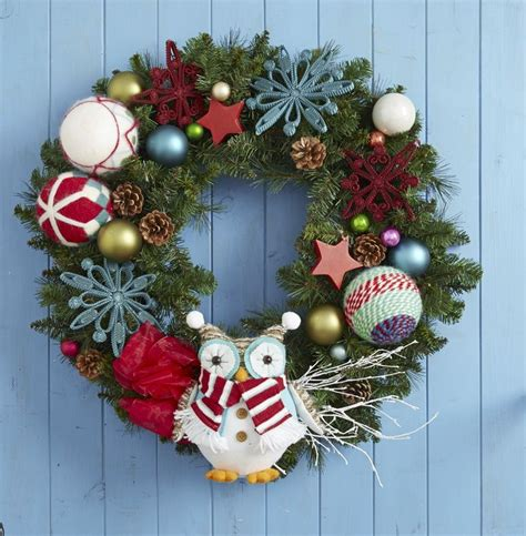 for a little christmas whimsy decorate a real or artificial holiday wreath with colorful fun