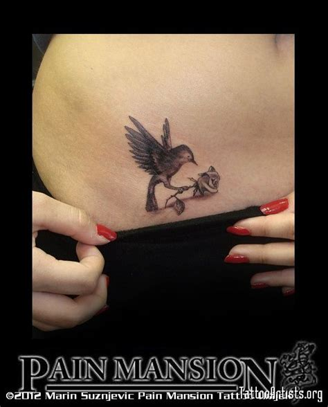 rose and bird tattoo small bird with rose tattoo pain