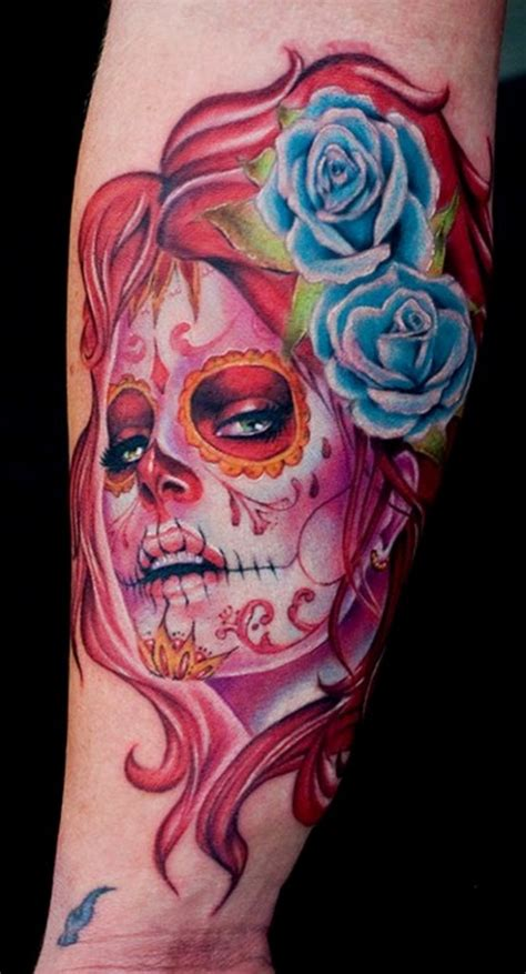 tattoo girl of the day arrogant day of the dead girl with blue roses in hair