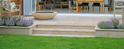 Modern House Design jura limestone terrace with lilly bowl water feature