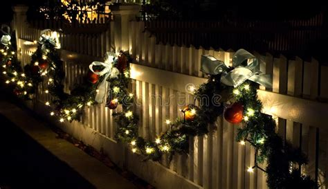 images of christmas garland on a fences fence decorations stock photo image of bows decorate 1712800
