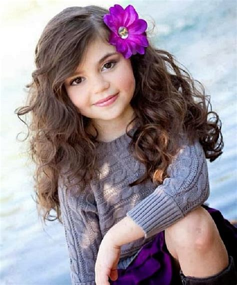 cute simple hairstyles for long curly hair with flower for