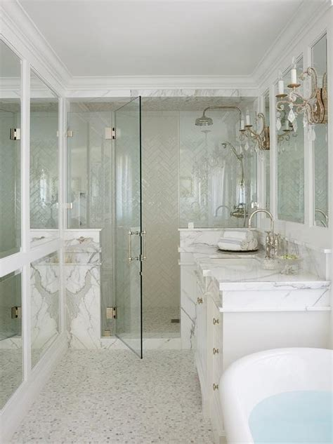 Glass walk in shower with white chevron tiles transitional bathroom