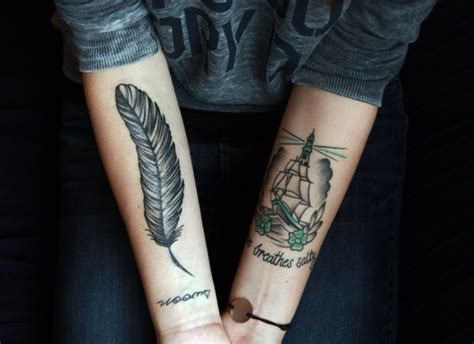 feather tattoo on girl s arm 35 cool feather tattoos desiznworld