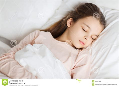 girls in bed girl sleeping in bed at home stock photo image 65611524