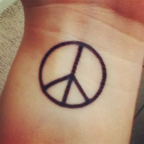 peaceful tattoos peace sign tattoos