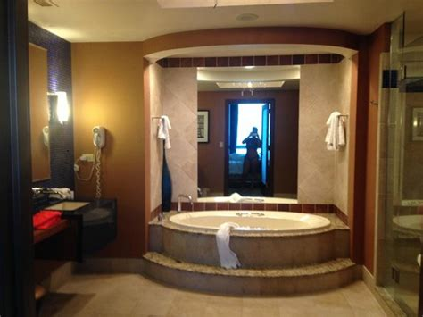 bathroom with picture of harrah s resort
