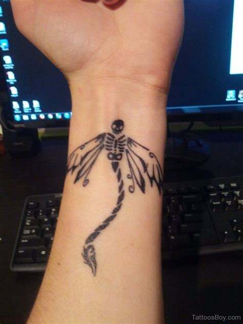 skull tattoos on wrist dragonfly tattoos designs pictures page 2