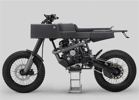 Mono Shock Scirpio Original t 005 cross motorcycle features boxy shaped tuvie