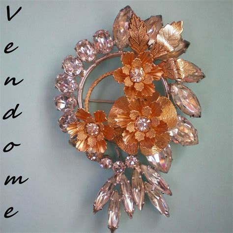Metal Brooch vendome rhinestone and gold metal flower brooch from