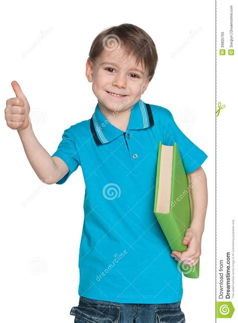 thumbs up my brown boy books boy with book holds his thumb up stock photo