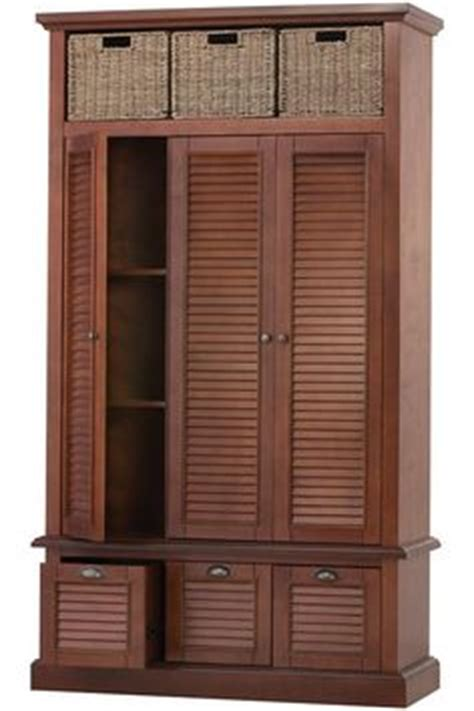entry hall armoire armoire for coats and linens by the front door since we