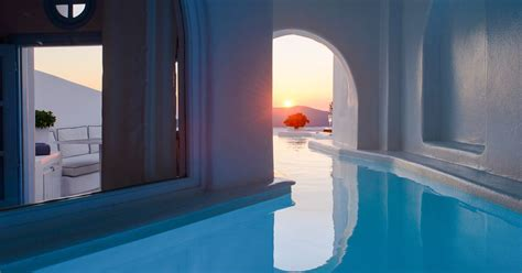 hotels with pools in the room this santorini hotel has rooms with secret tunnels leading to infinity pools and the