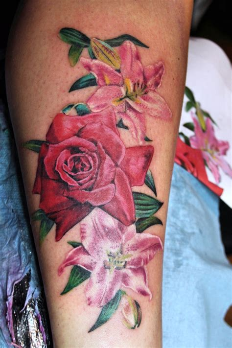 flowers tattoo by mirek vel stotker rose and lilies