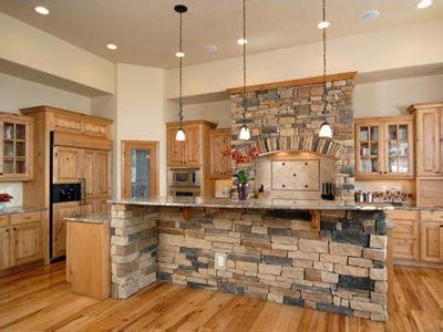 kitchen rock island island and stove highlighted by rock kitchen