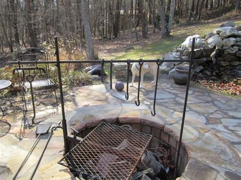 build a pit with cooking grill in your backyard