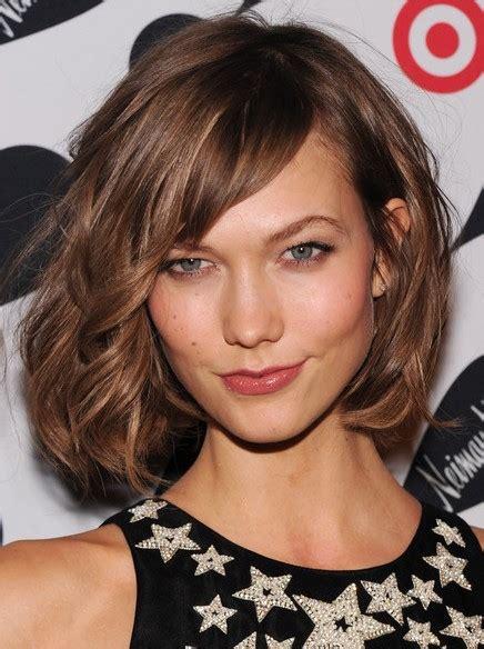 brown short curly hairstyles  side bangs