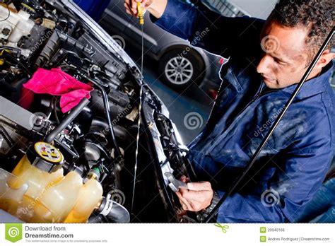 mechanic fixing a car stock photo image of cute dirty