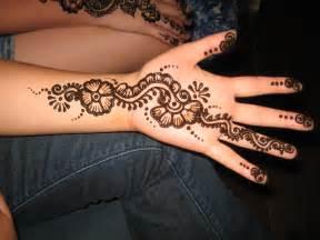 Henna flowers tattoos on hand