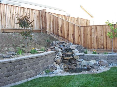 Water Feature Integrated Into Retaining Wall Though The Cheap Garden Wall