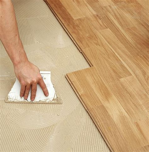 glue down installation bamboo hardwood floor over concrete slab wood sub floor