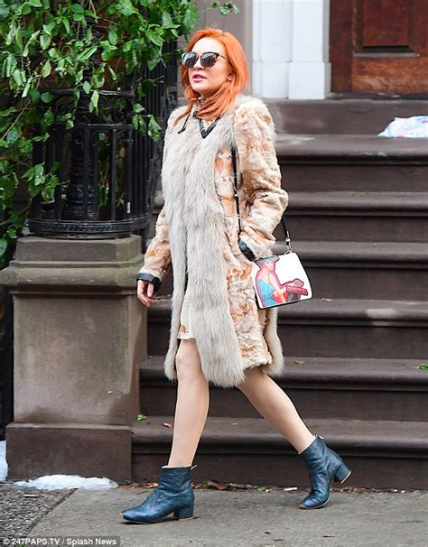 Lindsay Lohan Is Cold Possibly Literate by Lindsay Lohan Shows Signature Fiery Tresses
